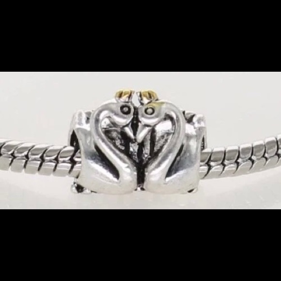 Authentic Retired Pandora swan embrace charm.